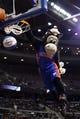 Jan 11, 2014; Auburn Hills, MI, USA; Detroit Pistons mascot Hooper dunks the ball during a time out against the Phoenix Suns at The Palace of Auburn Hills. Mandatory Credit: Rick Osentoski-USA TODAY Sports