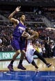 Jan 11, 2014; Auburn Hills, MI, USA; Detroit Pistons point guard Will Bynum (12) moves the ball while defended by Phoenix Suns shooting guard Gerald Green (14) in the second half at The Palace of Auburn Hills. Detroit won 110-108. Mandatory Credit: Rick Osentoski-USA TODAY Sports