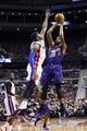 Jan 11, 2014; Auburn Hills, MI, USA; Phoenix Suns power forward Markieff Morris (11) shoots over Detroit Pistons small forward Josh Smith (6) in the first half at The Palace of Auburn Hills. Mandatory Credit: Rick Osentoski-USA TODAY Sports