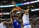 Jan 11, 2014; Philadelphia, PA, USA; Philadelphia 76ers shooting guard Tony Wroten (8) takes a shot as New York Knicks shooting guard J.R. Smith (8) defends during the game at the Wells Fargo Center. The New York Knicks won 102-92.Mandatory Credit: John Geliebter-USA TODAY Sports