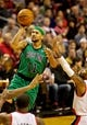 Jan 11, 2014; Portland, OR, USA; Boston Celtics point guard Jerryd Bayless (11) shoots over Portland Trail Blazers point guard Mo Williams (25) at the Moda Center. Mandatory Credit: Craig Mitchelldyer-USA TODAY Sports