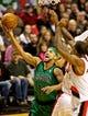 Jan 11, 2014; Portland, OR, USA; Boston Celtics point guard Jerryd Bayless (11) shoots over Portland Trail Blazers power forward Thomas Robinson (41) at the Moda Center. Mandatory Credit: Craig Mitchelldyer-USA TODAY Sports