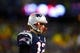 Jan 11, 2014; Foxborough, MA, USA; New England Patriots quarterback Tom Brady (12) looks to the sidelines during the fourth quarter of the 2013 AFC divisional playoff football game against the Indianapolis Colts at Gillette Stadium. Mandatory Credit: Andrew Weber-USA TODAY Sports