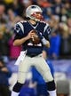 Jan 11, 2014; Foxborough, MA, USA; New England Patriots quarterback Tom Brady (12) throws a pass during the second quarter of the 2013 AFC divisional playoff football game against the Indianapolis Colts at Gillette Stadium. Mandatory Credit: Andrew Weber-USA TODAY Sports