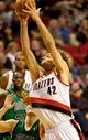 Jan 11, 2014; Portland, OR, USA; Portland Trail Blazers center Robin Lopez (42) shoots against the Boston Celtics at the Moda Center. Mandatory Credit: Craig Mitchelldyer-USA TODAY Sports