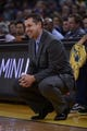 November 20, 2013; Oakland, CA, USA; Memphis Grizzlies head coach David Joerger smiles during the fourth quarter against the Golden State Warriors at Oracle Arena. The Grizzlies defeated the Warriors 88-81 in overtime. Mandatory Credit: Kyle Terada-USA TODAY Sports
