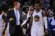 November 20, 2013; Oakland, CA, USA; Golden State Warriors assistant coach Brian Scalabrine (left) instructs small forward Andre Iguodala (9) during the fourth quarter against the Memphis Grizzlies at Oracle Arena. The Grizzlies defeated the Warriors 88-81 in overtime. Mandatory Credit: Kyle Terada-USA TODAY Sports