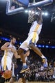 November 20, 2013; Oakland, CA, USA; Golden State Warriors small forward Harrison Barnes (40) dunks the basketball during the fourth quarter against the Memphis Grizzlies at Oracle Arena. The Grizzlies defeated the Warriors 88-81 in overtime. Mandatory Credit: Kyle Terada-USA TODAY Sports