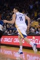 November 20, 2013; Oakland, CA, USA; Golden State Warriors shooting guard Klay Thompson (11) celebrates after a three-point basket during the fourth quarter against the Memphis Grizzlies at Oracle Arena. The Grizzlies defeated the Warriors 88-81 in overtime. Mandatory Credit: Kyle Terada-USA TODAY Sports