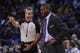 December 3, 2013; Oakland, CA, USA; Toronto Raptors head coach Dwane Casey (right) argues with NBA referee Ken Mauer (41) during the fourth quarter against the Golden State Warriors at Oracle Arena. The Warriors defeated the Raptors 112-103. Mandatory Credit: Kyle Terada-USA TODAY Sports