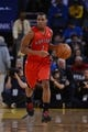 December 3, 2013; Oakland, CA, USA; Toronto Raptors point guard Kyle Lowry (7) dribbles the basketball during the first quarter against the Golden State Warriors at Oracle Arena. The Warriors defeated the Raptors 112-103. Mandatory Credit: Kyle Terada-USA TODAY Sports