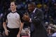 December 3, 2013; Oakland, CA, USA; Toronto Raptors head coach Dwane Casey (right) argues with NBA referee Marat Kogut (68) during the third quarter against the Golden State Warriors at Oracle Arena. The Warriors defeated the Raptors 112-103. Mandatory Credit: Kyle Terada-USA TODAY Sports