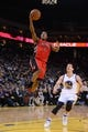 December 3, 2013; Oakland, CA, USA; Toronto Raptors point guard Kyle Lowry (7) drives to the basket against Golden State Warriors point guard Nemanja Nedovic (8) during the first quarter at Oracle Arena. The Warriors defeated the Raptors 112-103. Mandatory Credit: Kyle Terada-USA TODAY Sports