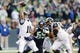 Dec 29, 2013; Seattle, WA, USA; St. Louis Rams quarterback Kellen Clemens (10) passes the ball during the game against the Seattle Seahawks at CenturyLink Field. Seattle defeated St. Louis 27-9. Mandatory Credit: Steven Bisig-USA TODAY Sports
