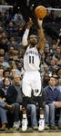 Jan 7, 2014; Memphis, TN, USA; Memphis Grizzlies point guard Mike Conley (11) takes a shoot drives to the basket against the San Antonio Spurs at FedExForum. the San Antonio Spurs beat the Memphis Grizzlies 110 - 108 Mandatory Credit: Justin Ford-USA TODAY Sports