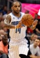 Dec 13, 2013; Orlando, FL, USA; Orlando Magic point guard Jameer Nelson (14) passes the ball against the Cleveland Cavaliers during the second half at Amway Center. Cleveland Cavaliers defeated the Orlando Magic 109-100. Mandatory Credit: Kim Klement-USA TODAY Sports