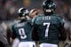 Jan 4, 2014; Philadelphia, PA, USA; Philadelphia Eagles quarterback Michael Vick (7) looks on as quarterback Nick Foles (9) warms up before the 2013 NFC wild card playoff football game against the New Orleans Saints at Lincoln Financial Field. Mandatory Credit: Joe Camporeale-USA TODAY Sports