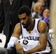 Jan 7, 2014; Memphis, TN, USA; Memphis Grizzlies point guard Mike Conley (11) during a timeout against the San Antonio Spurs at FedExForum. the San Antonio Spurs beat the Memphis Grizzlies 110 - 108 Mandatory Credit: Justin Ford-USA TODAY Sports