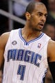 Dec 13, 2013; Orlando, FL, USA; Orlando Magic shooting guard Arron Afflalo (4) against the Cleveland Cavaliers during the second half at Amway Center. Cleveland Cavaliers defeated the Orlando Magic 109-100. Mandatory Credit: Kim Klement-USA TODAY Sports