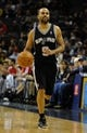 Jan 7, 2014; Memphis, TN, USA; San Antonio Spurs point guard Tony Parker (9) brings the ball up court during the first quarter against the Memphis Grizzlies at FedExForum. the San Antonio Spurs beat the Memphis Grizzlies 110 - 108 Mandatory Credit: Justin Ford-USA TODAY Sports