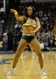 Jan 7, 2014; Memphis, TN, USA; Memphis Grizzlies cheerleader performs during timeout against the San Antonio Spurs at FedExForum. the San Antonio Spurs beat the Memphis Grizzlies 110 - 108 Mandatory Credit: Justin Ford-USA TODAY Sports