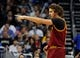 Dec 13, 2013; Orlando, FL, USA; Cleveland Cavaliers center Anderson Varejao (17) points against the Orlando Magic during the second half at Amway Center. Cleveland Cavaliers defeated the Orlando Magic 109-100. Mandatory Credit: Kim Klement-USA TODAY Sports