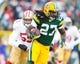 Jan 5, 2014; Green Bay, WI, USA; Green Bay Packers running back Eddie Lacy (27) during the 2013 NFC wild card playoff football game against the San Francisco 49ers at Lambeau Field.  San Francisco won 23-20.  Mandatory Credit: Jeff Hanisch-USA TODAY Sports