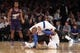 Jan 13, 2014; New York, NY, USA; New York Knicks shooting guard Toure' Murry (23) collides with shooting guard Tim Hardaway Jr. (5) in front of Phoenix Suns point guard Ish Smith (3) during the second quarter of a game at Madison Square Garden. Mandatory Credit: Brad Penner-USA TODAY Sports