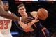 Jan 13, 2014; New York, NY, USA; Phoenix Suns shooting guard Goran Dragic (1) passes the ball while defended by New York Knicks shooting guard Toure' Murry (23) during the second quarter of a game at Madison Square Garden. Mandatory Credit: Brad Penner-USA TODAY Sports