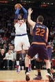 Jan 13, 2014; New York, NY, USA; New York Knicks small forward Carmelo Anthony (7) shoots over Phoenix Suns center Miles Plumlee (22) during overtime of a game at Madison Square Garden. The Knicks defeated the Suns 98-96 in overtime. Mandatory Credit: Brad Penner-USA TODAY Sports