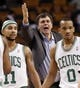 Jan 13, 2014; Boston, MA, USA; Houston Rockets head coach Kevin McHale talks to a referee between Boston Celtics point guard Jerryd Bayless (11) and point guard Avery Bradley (0) during the second half of Houston's 104-92 win at TD Garden. Mandatory Credit: Winslow Townson-USA TODAY Sports