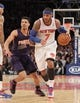 Jan 13, 2014; New York, NY, USA; New York Knicks small forward Carmelo Anthony (7) drives past Phoenix Suns shooting guard Gerald Green (14) during the fourth quarter of a game at Madison Square Garden. The Knicks defeated the Suns 98-96 in overtime. Mandatory Credit: Brad Penner-USA TODAY Sports