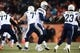 Dec 12, 2013; Denver, CO, USA; San Diego Chargers quarterback Philip Rivers (17) during a play action with  running back Ronnie Brown (23)  in the second quarter against the Denver Broncos at Sports Authority Field at Mile High. Mandatory Credit: Ron Chenoy-USA TODAY Sports