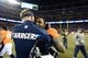Dec 12, 2013; Denver, CO, USA; Denver Broncos running back Knowshon Moreno (27) hugs San Diego Chargers head coach Mike McCoy following the game at Sports Authority Field at Mile High. The San Diego Chargers defeated the Denver Broncos 27-20. Mandatory Credit: Ron Chenoy-USA TODAY Sports
