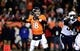 Dec 12, 2013; Denver, CO, USA; Denver Broncos quarterback Peyton Manning (18) prepares to pass in the fourth quarter against the San Diego Chargers at Sports Authority Field at Mile High. The San Diego Chargers defeated the Denver Broncos 27-20. Mandatory Credit: Ron Chenoy-USA TODAY Sports