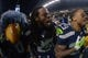 Dec 2, 2013; Seattle, WA, USA; Seattle Seahawks mascot Blitz (left), cornerback Richard Sherman (25) and free safety Earl Thomas (29) celebrate after the game against the New Orleans Saints at CenturyLink Field. The Seahawks defeated the Saints 34-7. Mandatory Credit: Kirby Lee-USA TODAY Sports