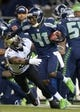 Dec 2, 2013; Seattle, WA, USA; Seattle Seahawks cornerback Byron Maxwell (41) is pursued by New Orleans Saints running back Mark Ingram (22) on an interception return at CenturyLink Field. The Seahawks defeated the Saints 34-7. Mandatory Credit: Kirby Lee-USA TODAY Sports