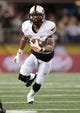 Jan 3, 2014; Arlington, TX, USA; Oklahoma State Cowboys wide receiver Josh Stewart (5) runs with the ball against the Missouri Tigers at the 2014 Cotton Bowl at AT&T Stadium. Missouri beat Oklahoma State 41-31. Mandatory Credit: Tim Heitman-USA TODAY Sports
