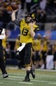 Jan 3, 2014; Arlington, TX, USA; Missouri Tigers quarterback Corbin Berkstresser (13) throws a pass before the game against the Oklahoma State Cowboys at the 2014 Cotton Bowl at AT&T Stadium. Mandatory Credit: Tim Heitman-USA TODAY Sports