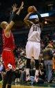 Jan 10, 2014; Milwaukee, WI, USA; Milwaukee Bucks guard O.J. Mayo (00) during the game against the Chicago Bulls at BMO Harris Bradley Center.  Chicago won 81-72.  Mandatory Credit: Jeff Hanisch-USA TODAY Sports
