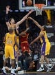 Jan 14, 2014; Los Angeles, CA, USA; Los Angeles Lakers center Pau Gasol (16) and shooting guard Wesley Johnson (11) blocks a shot by Cleveland Cavaliers point guard Kyrie Irving (2) in the second half of the game at Staples Center. Cleveland Cavaliers won 120-118. Mandatory Credit: Jayne Kamin-Oncea-USA TODAY Sports