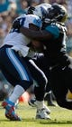 Dec 22, 2013; Jacksonville, FL, USA; Jacksonville Jaguars linebacker LaRoy Reynolds (56) tackles Tennessee Titans running back Shonn Greene (23) during the first half at EverBank Field. Mandatory Credit: Kim Klement-USA TODAY Sports