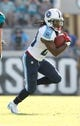 Dec 22, 2013; Jacksonville, FL, USA;Tennessee Titans running back Chris Johnson (28) runs with the ball against the Jacksonville Jaguars  during the first half at EverBank Field. Mandatory Credit: Kim Klement-USA TODAY Sports