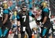 Dec 22, 2013; Jacksonville, FL, USA; Jacksonville Jaguars quarterback Chad Henne (7) high fives guard Jacques McClendon (66) and teammates after they scored against the Tennessee Titans during the first half at EverBank Field. Mandatory Credit: Kim Klement-USA TODAY Sports