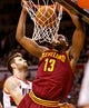 Jan 15, 2014; Portland, OR, USA; Cleveland Cavaliers power forward Tristan Thompson (13) dunks the ball over Portland Trail Blazers center Joel Freeland (19) at the Moda Center. Mandatory Credit: Craig Mitchelldyer-USA TODAY Sports