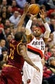 Jan 15, 2014; Portland, OR, USA; Portland Trail Blazers point guard Mo Williams (25) shoots over Cleveland Cavaliers power forward Tristan Thompson (13) at the Moda Center. Mandatory Credit: Craig Mitchelldyer-USA TODAY Sports