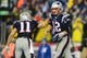 Jan 11, 2014; Foxborough, MA, USA; New England Patriots quarterback Tom Brady (12) and wide receiver Julian Edelman (11) during the fourth quarter of the 2013 AFC divisional playoff football game against the Indianapolis Colts at Gillette Stadium. Mandatory Credit: Andrew Weber-USA TODAY Sports