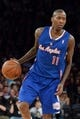 Jan 17, 2014; New York, NY, USA; Los Angeles Clippers shooting guard Jamal Crawford (11) dribbles against the New York Knicks during the first half at Madison Square Garden. The Los Angeles Clippers won 109-94. Mandatory Credit: Joe Camporeale-USA TODAY Sports