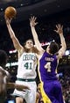 Jan 17, 2014; Boston, MA, USA; Boston Celtics center Kelly Olynyk (41) shoots against Los Angeles Lakers power forward Ryan Kelly (4) in the second half at TD Garden. The Los Angeles Lakers defeated the Celtics 107-104. Mandatory Credit: David Butler II-USA TODAY Sports