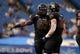 Dec 23, 2013; St. Petersburg, FL, USA; East Carolina Pirates linebacker Derrell Johnson (56) talks with linebacker Kyle Tudor (20) against the Ohio Bobcats during the first quarter at the 2013 Beef O Bradys Bowl at Tropicana Field. Mandatory Credit: Kim Klement-USA TODAY Sports